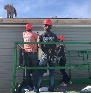 EPOCH staff members volunteering at the build!