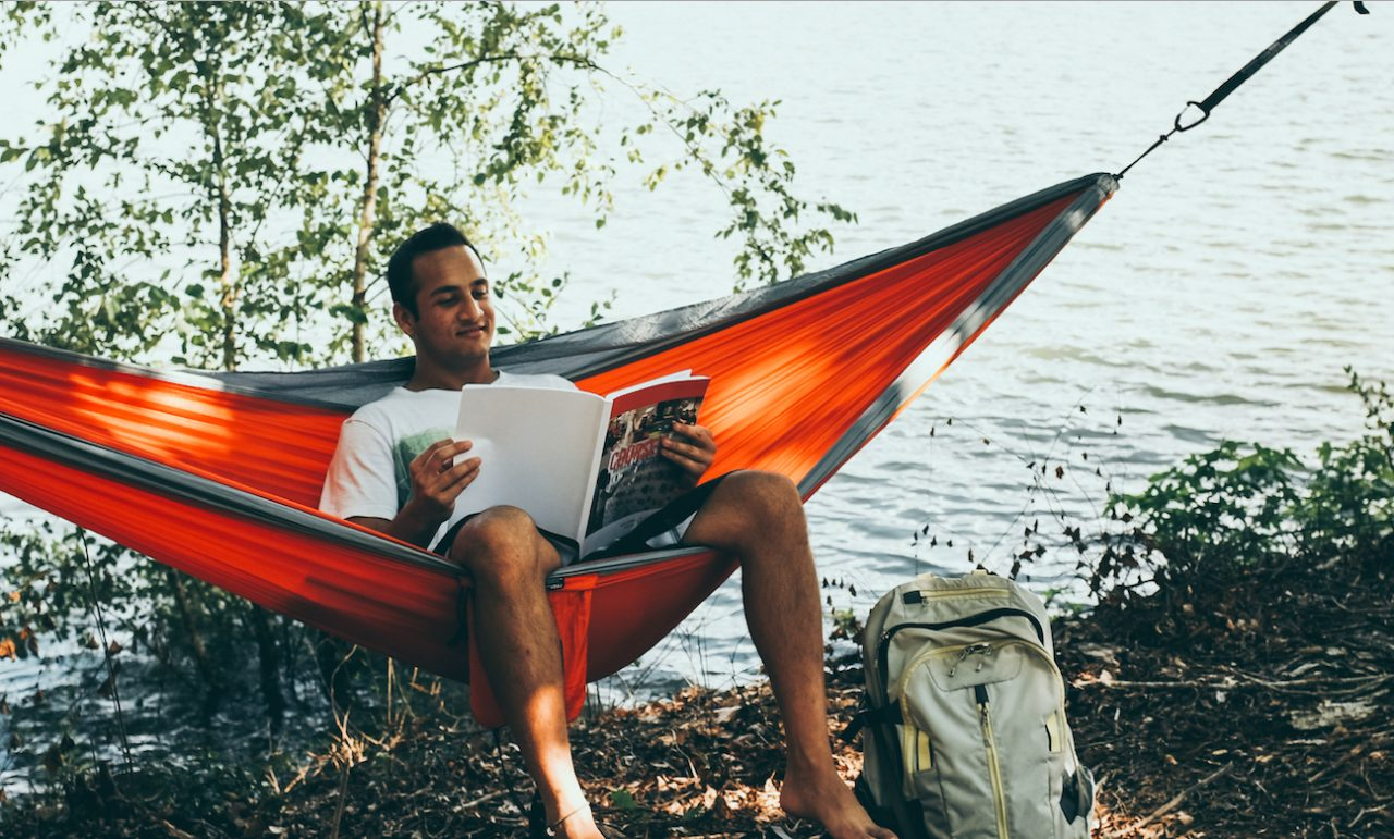 Male student on hammock during college summer break