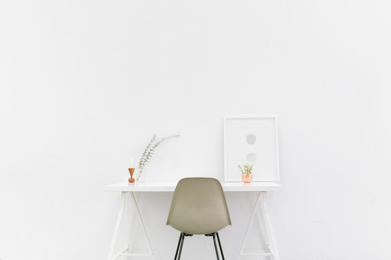 White desk and chair in white room