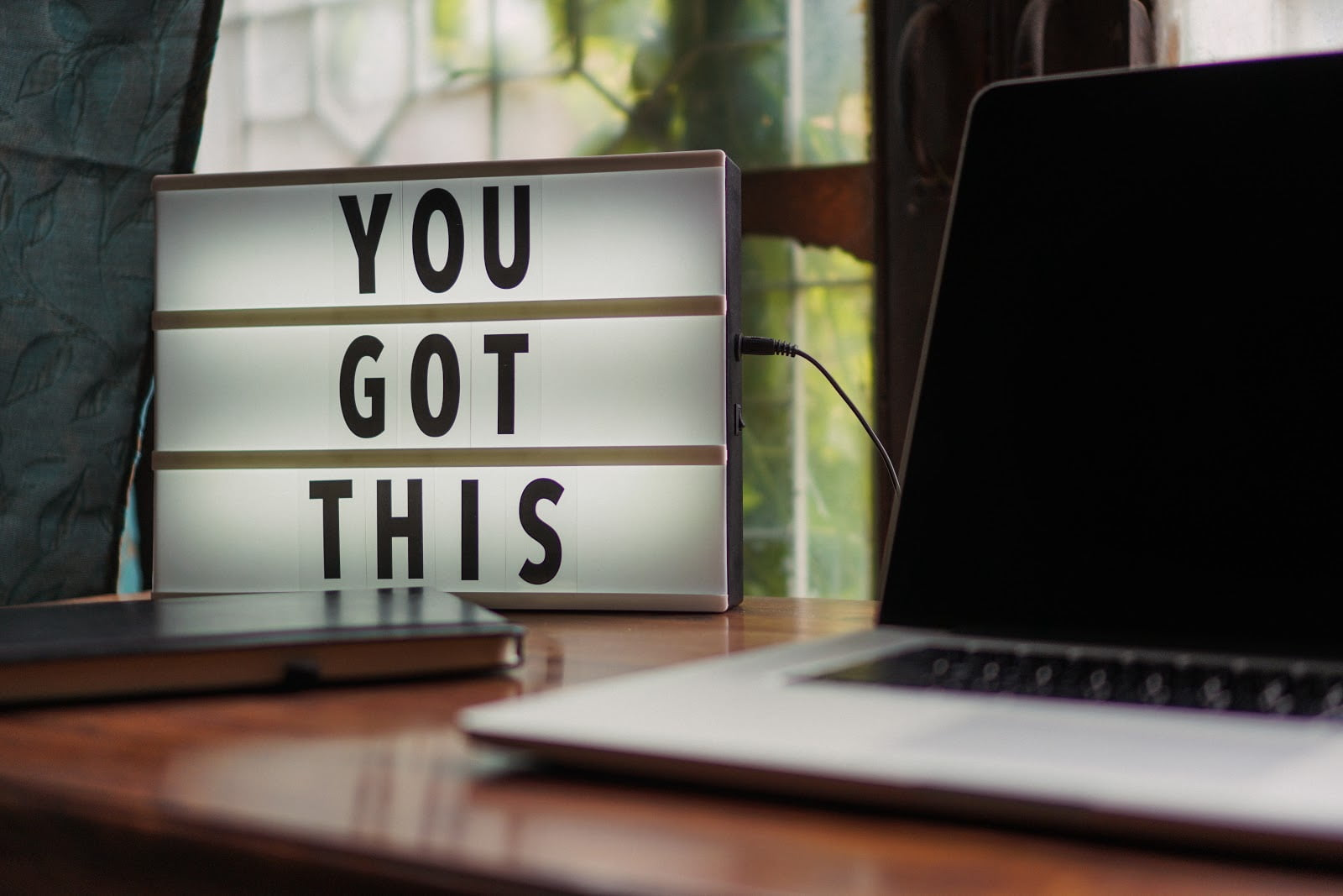 You got this sign on desk next to laptop