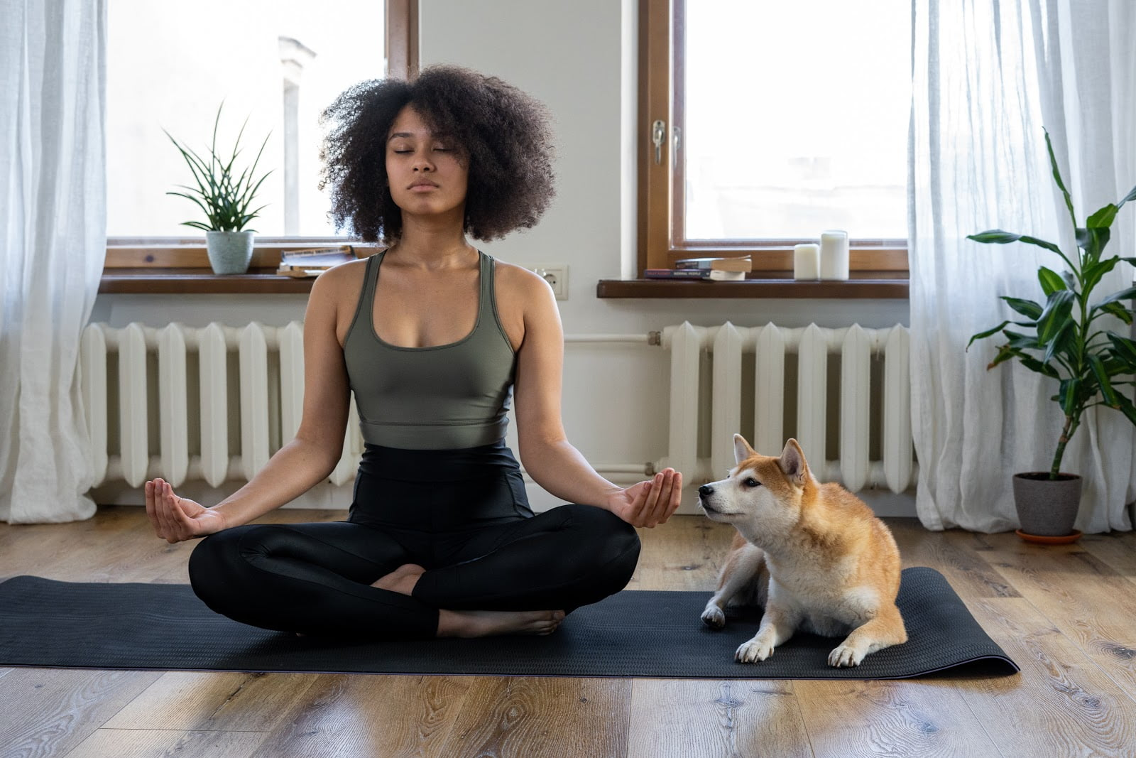 girl meditating with dog